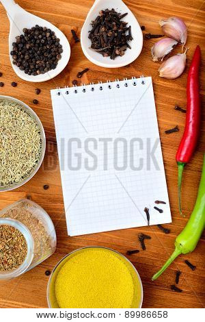 Copyspace food frame with notepad paper spices and cooking accesories