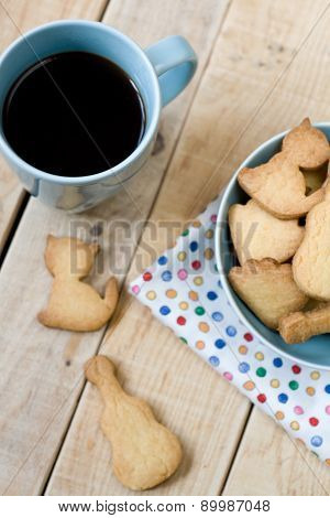 Sweet Tasty Cookies In The Blue Plate And Cup Of Black Coffee On The Wooden Unpainted Background.