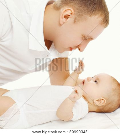 Happy Father With His Baby On The Bed At Home