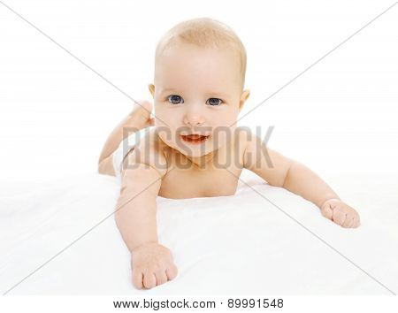Portrait Of Cute Infant In Diapers Lying On The Sheet