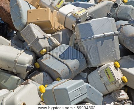 Bunch Of Old Gas Meters In A Contaneir Of The Landfill