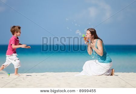 Mother And Son Making Soap Bubbles