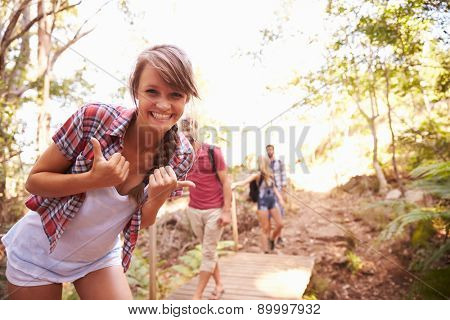 Woman On Walk With Friends Making Funny Gesture At Camera