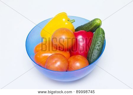 Different whole vegetables of different colors in a bowl for a salad