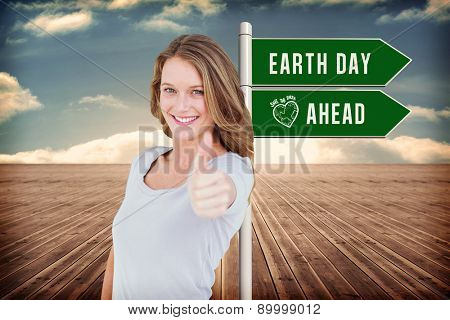 Smiling woman against wooden planks leading to blue sky