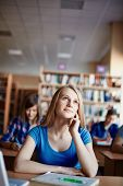 image of daydreaming  - Cute girl daydreaming at lesson in college - JPG