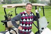 picture of buggy  - Happy golfer beside his golf buggy on a sunny day at the golf course - JPG