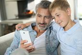 picture of daddy  - Daddy with son playing with smartphone - JPG