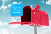 picture of postbox  - Red email postbox against blue sky - JPG