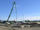 image of burlington  - concrete pumping truck pours the foundation for yet another fast food restaurant - JPG