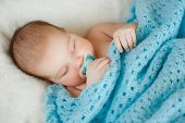 Picture of the little boy is sleeping.