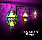 pic of occasion  - Beautiful Elegant Ramadan Kareem Lanterns or Fanous Hanging in Wall With Colorful Lights in Night Background for the Holy Month Occasion of fasting - JPG