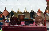foto of flea  - many copper objects for kitchen and home for sale in the antiques stall at flea market - JPG