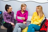 picture of training room  - Happy girls in locker room after fitness training - JPG