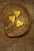 picture of ghee  - ghee or melted butter in heart shape on wholemeal bread - JPG