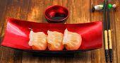foto of siomai  - Vietnam style steamed shrimp dumplings served on a wood table top - JPG