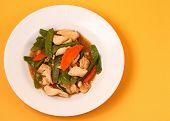 stock photo of stir fry  - chicken stir fry thai style on an orange background - JPG