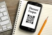 picture of qr-code  - discount coupon qr code on mobile phone - JPG