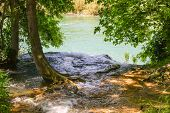 foto of flow  - the flow of water flowing into the river from the shore - JPG