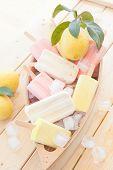 stock photo of popsicle  - Variety of frozen fruit popsicles in little wooden boat - JPG