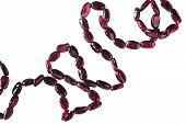 pic of beads  - String of garnet beads on white background - JPG