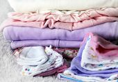stock photo of dowry  - Pile of baby clothes close up  - JPG