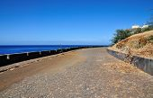image of cobblestone  - Guard rail protects a cobblestone road over the oceanfront of Sao Filipe on the island of Fog Cabo Verde - JPG