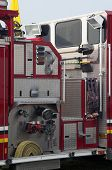 picture of fire truck  - Detail of portion of fire truck showing hoses and tools - JPG