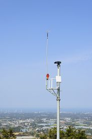 stock photo of lightning-rod  - lgihtning rod and cctv camera for fire prevention at the top of Jeoji Oreum in Jeju Island Korea - JPG