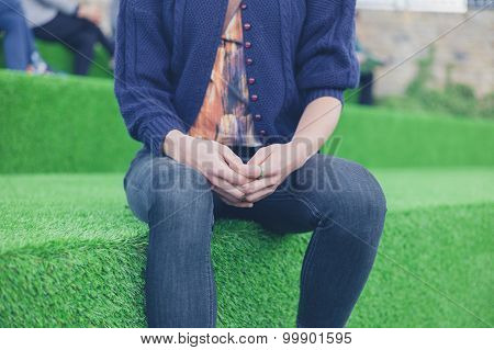 Woman Sitting On Astro Turf