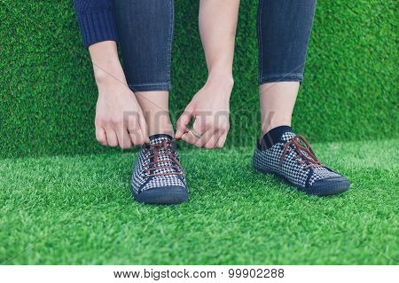 Woman Tying Her Shoe Laces