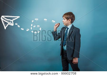 Teenage boy in suit businessman admits paper airplane strategy a