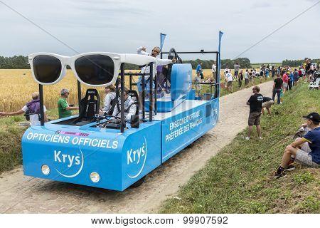 Krys Vehicle On A Cobblestone Road- Tour De France 2015