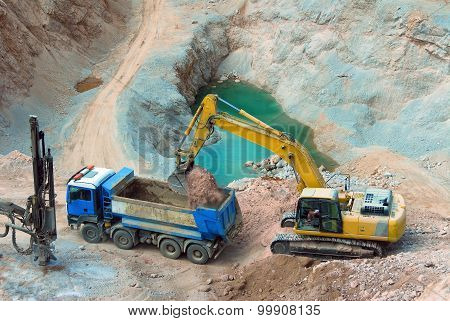 big yellow wheel work in a quarry