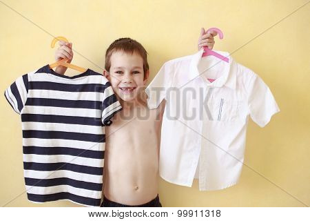 boy is trying on clothes
