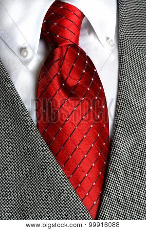White dress shirt with red tie detailed closeup