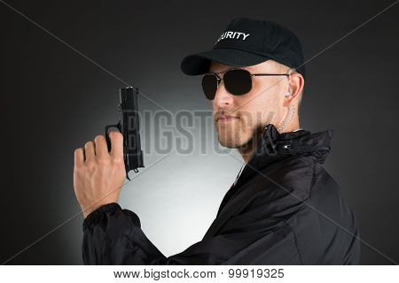 Male Bodyguard With Gun