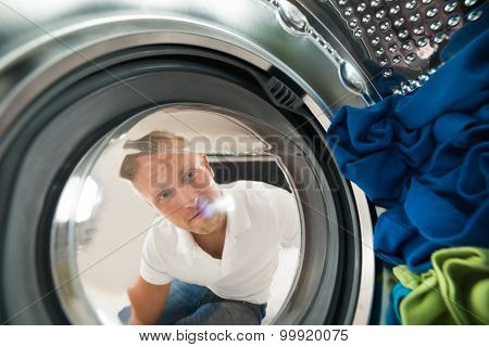 Portrait Of Man View From Inside The Washing Machine