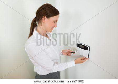 Businesswoman Operating Door Security System