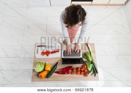 Woman Looking For Recipe On Laptop