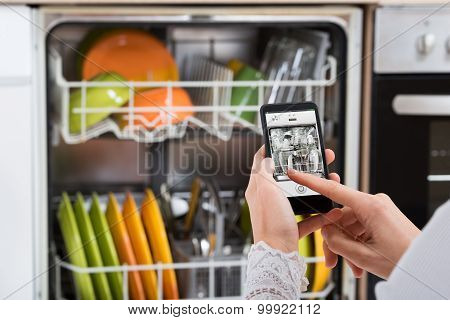 Person Hands Operating Dishwasher