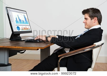 Businessman Analyzing Graph On Computer