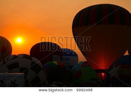 Sun Rising over Balloons and Flames