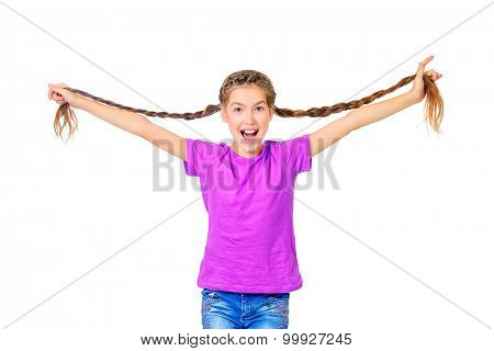 Cheerful teen girl in bright casual clothes holds her long braids. Hair, haircare. Studio shot. Isolated over white.