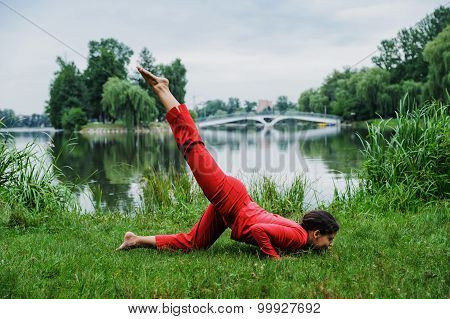 Beautiful Young Woman Performing Yoga Exercises