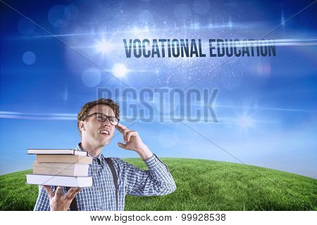 The word vocational education and geeky student holding a pile of books against green hill under blue sky