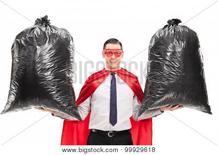 young superhero holding two trash bags isolated on white background
