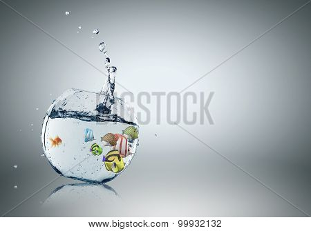 Exotic fish in round aquarium with clear blue water