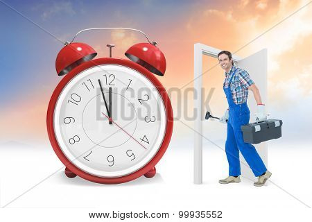 Plumber carrying plunger and tool box against alarm clock counting down to twelve