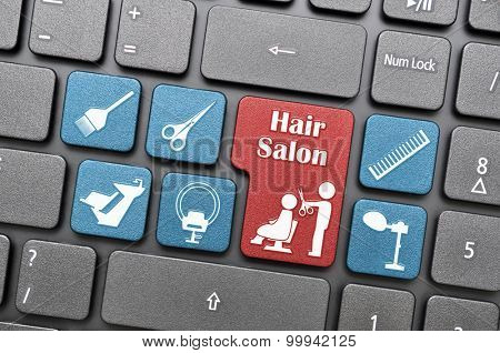 Red and blue hair salon key on keyboard